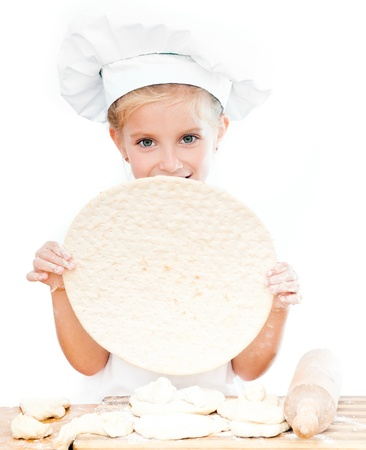 cute little girl with pizza dough on white background photo
