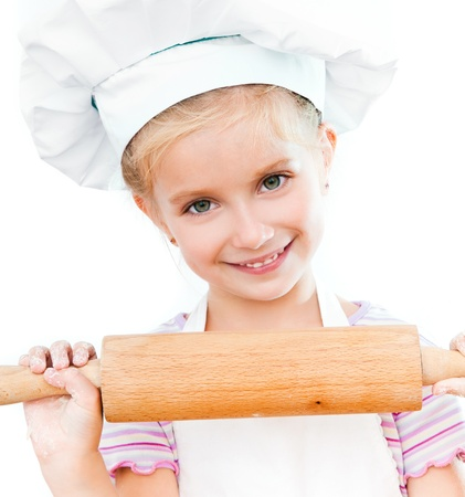 beautiful little girl with a rolling pin on a white background photo
