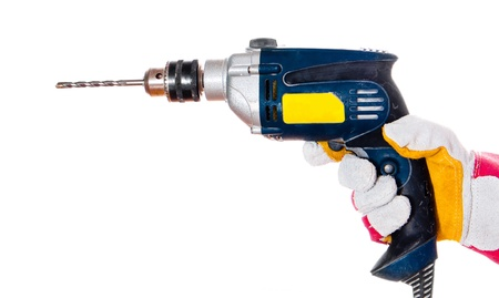 gloved hand with a drill isolated on a white background photo