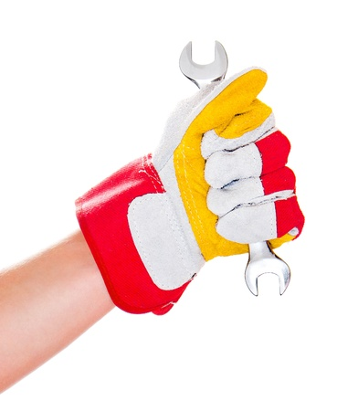forkwrench: gloved hand with a wrench isolated on a white background