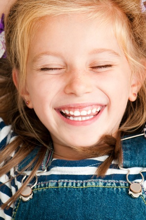 one eye closed: cute smiling girl with closed eyes