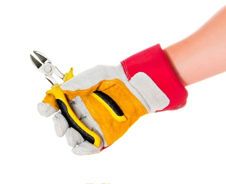 gloved hand with a cutters isolated on a white background photo