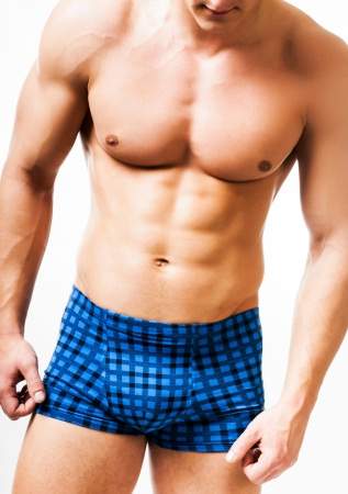 male torso: athletic man on a white background