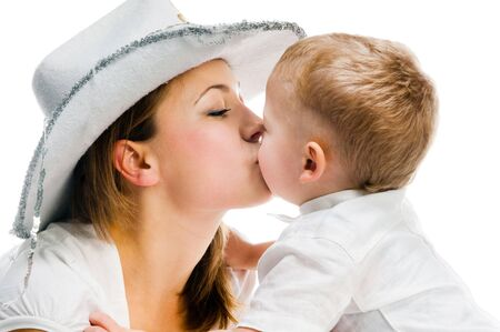 Mother kissing son on a white background photo