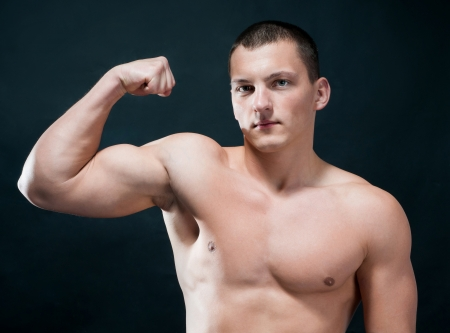 Handsome muscular man isolated on black photo