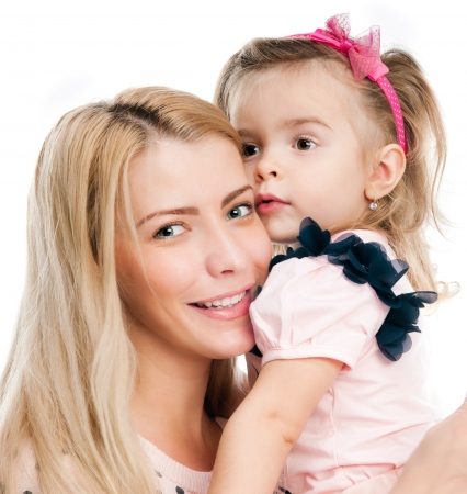 atcamera: Mother with little daughter on white background