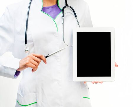 Doctor with a digital tablet and pen isolated on white background photo