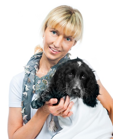 cocker spaniel and young woman on white background photo