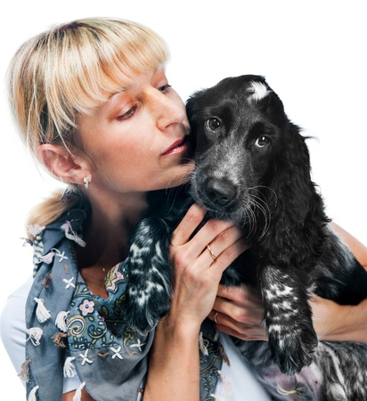 Young cocker spaniel and young woman on white background photo