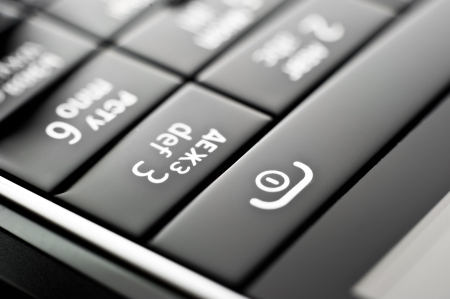 cell phone: Glass phone button close up Stock Photo