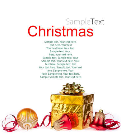 Gold gift and colorful decorations on a white background with sample text photo
