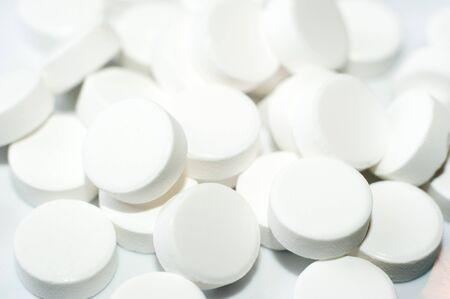 aspirin: Macro of white pills closeup