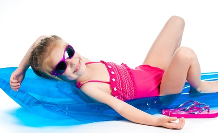 little girl beach: cute little girl in a swimming suit on an inflatable mattress