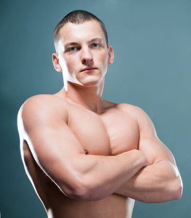 strong athletic man on grey background photo