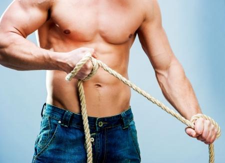 bare chest: Attractive muscular man torso rope breaks
