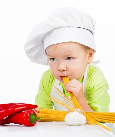 little boy with raw spaghetti photo