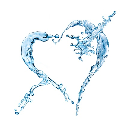 water splash in heart shape isolated on a white background photo