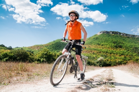 Person riding a mountiain bike on a slope Stock Photo - 18230597
