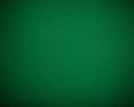 texas hold em: Mesa de p�quer sent�a fondo en color verde Foto de archivo
