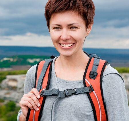 Portrait of smiling girl on a mountain hill Stock Photo - 18230324