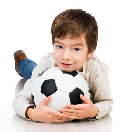 Little boy soccer ball lying on white floor photo