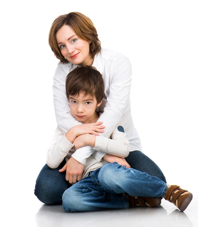 children holding hands: happy mother with son over white Stock Photo