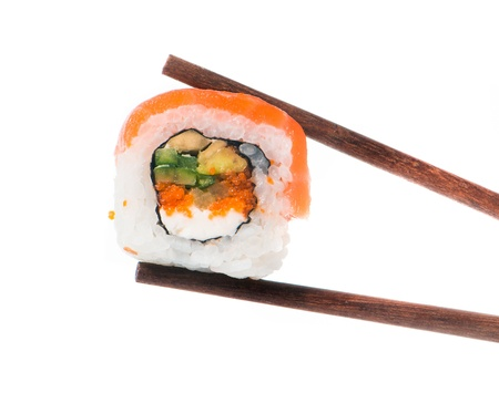 Sushi in chopsticks isolated on a white background