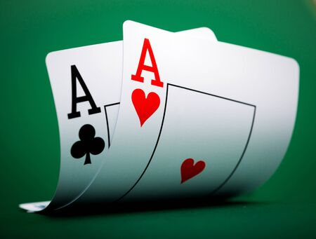 card game: playing cards on a green table casino