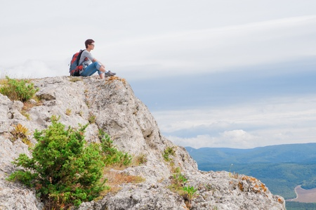 irl sitting on a mountain and looking on the valley Stock Photo - 18230409