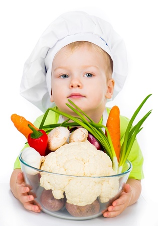 cute boy with vegetables isolated on a white photo