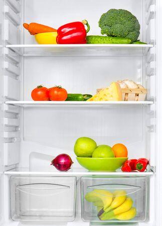 vertical fridge: open fridge with fresh vegetables