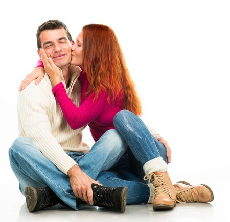 happy couple white background: Beautiful Young happy couple kissing on white background Stock Photo