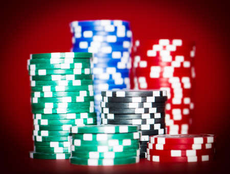 stacks of chips for poker on red table photo