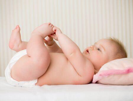 nude baby: portrait of a cute little baby lying