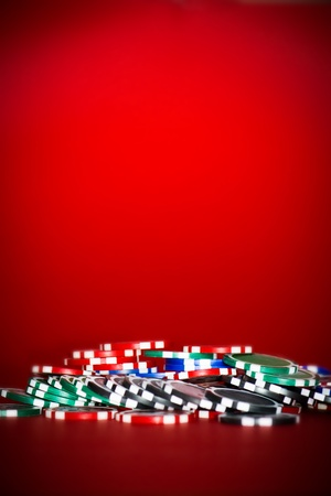 chips for poker on red table with place for text photo