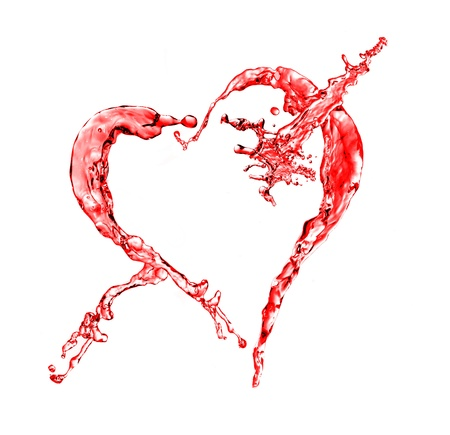 Red water splash in heart shape isolated on a white background photo