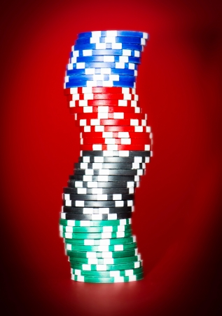 stack of chips on red poker table photo