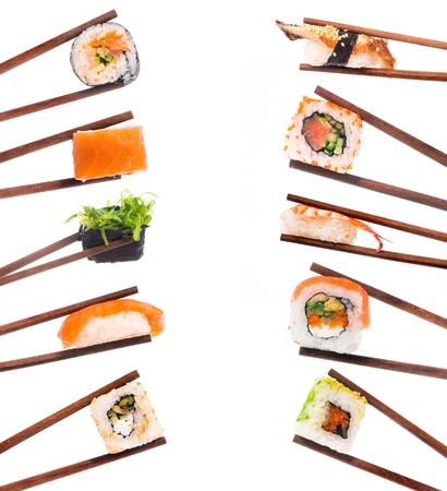 Set of sushi with chopsticks shot on white