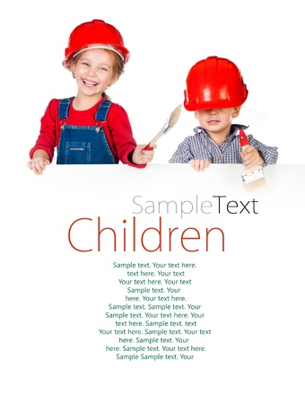 Pretty little girl and boy in halmet holding white banner with sample text Stock Photo - 18849131