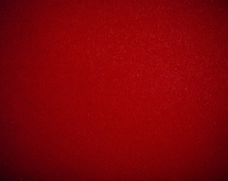 rummy: Poker table felt background in red color