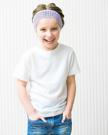 cute little girls: smiling little girl in white t-shirt