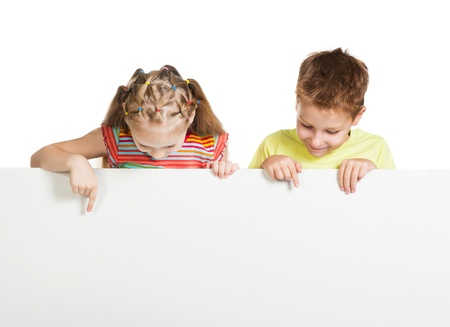 girl and boy beside a white blank
