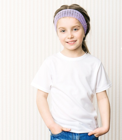little girl in a white tshirt photo