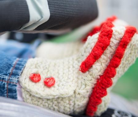 Children s feet in socks close up photo