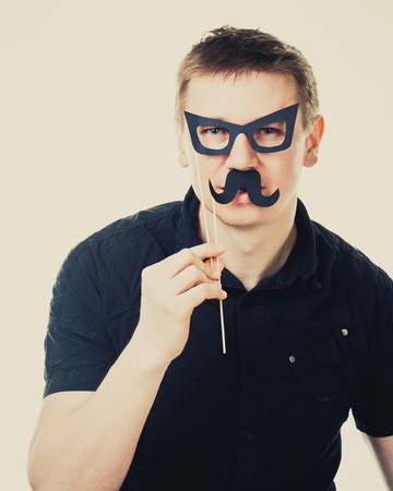 black head and moustache: funny man with fake glasses and a mustache