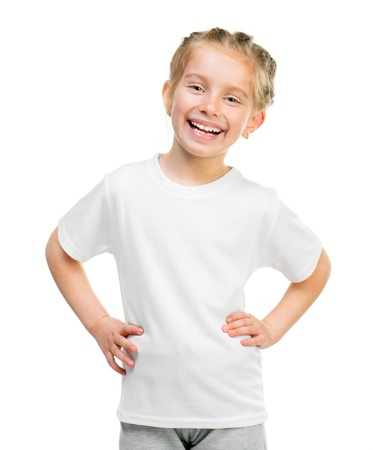 Cute little girl in white t shirt over white background photo