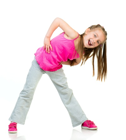 young girl gymnast isolated on a white background photo