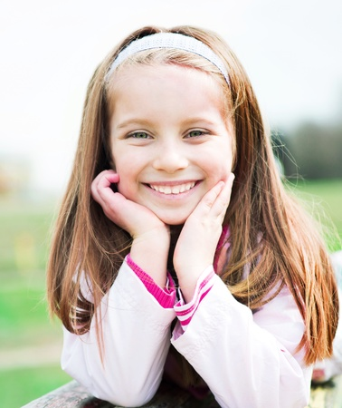 cute little girl smiling: Close-up portrait of a beautiful liitle girl Stock Photo