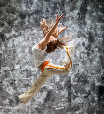 jumping girl on a gray grunge background