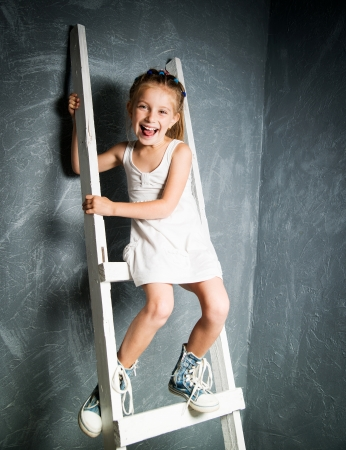 little girl on the white stairs